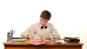School boy doing his homework thinking about the stock footage