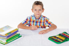 School boy is doing his homework Stock Photo
