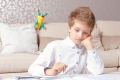 School boy doing home tasks Royalty Free Stock Photography