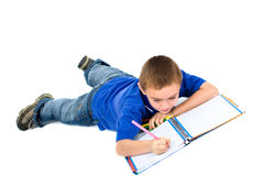 School boy doing homework Stock Photo