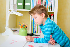 School boy doing homework at home Stock Photography