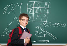 School boy with drawing on board Royalty Free Stock Photography