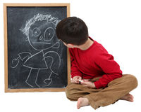 School Boy Drawing on Chalkboard Royalty Free Stock Image