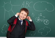 School boy drawing fun on board Royalty Free Stock Image