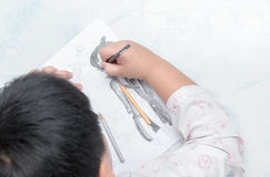 School boy drawing picture with color pencil, Stock Photo