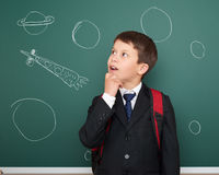 School boy drawing space rocket on board Royalty Free Stock Photography