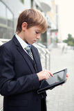 School boy with electronic tablet Stock Images