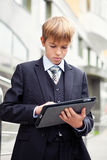 School boy with electronic tablet Stock Photos