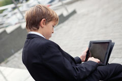 School boy with electronic tablet sitting, Stock Photos