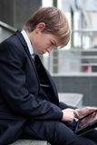 School boy with electronic tablet sitting, Royalty Free Stock Images