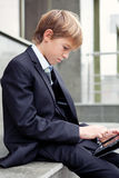 School boy with electronic tablet sitting, Royalty Free Stock Image