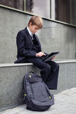 School boy with electronic tablet sitting, Stock Photography