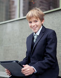 School boy with electronic tablet sitting, Stock Image