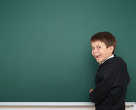 School boy on empty board Stock Photo
