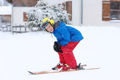 School boy enjoying winter ski vacation Stock Photo