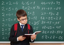 School boy exercise math on board Stock Image