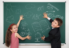 School boy and girl draw on board Royalty Free Stock Image
