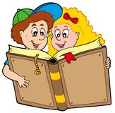 School boy and girl reading book Royalty Free Stock Photos