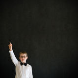School boy hands up answering question Stock Photography