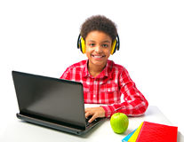 School boy with headset and laptop Stock Photos
