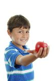 School boy holding an apple Stock Images