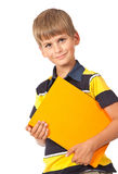 School boy is holding a book. Isolated on white background Stock Images