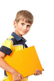 School boy is holding a book. Isolated on white background Stock Photo