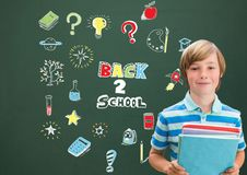 School boy holding books and Back to school Education drawing on blackboard. Digital composite of School boy holding books and Back to school Education drawing royalty free stock photos