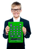 School boy holding calculator upside down. New way to greet hello. School boy holding calculator upside down stock illustration