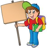 School boy holding wooden board Stock Images