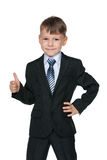 School boy holds his thumb up Stock Images