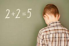 School. Boy incorrectly decisive simple mathematical example Stock Image