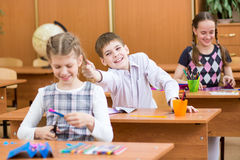 School boy indulging at lesson in classroom Royalty Free Stock Photography