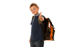 School boy isolated over white background. A school boy isolated over white background Royalty Free Stock Photography