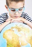 School boy looking at globe Stock Photography