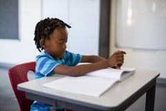 School boy memorizing the lesson in classroom Royalty Free Stock Photo