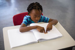 School boy memorizing the lesson in classroom Stock Photos