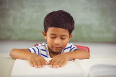 School boy memorizing the lesson in classroom Stock Images