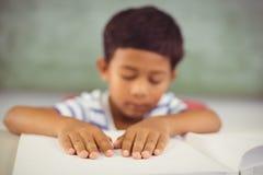 School boy memorizing the lesson in classroom Royalty Free Stock Photos