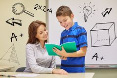 School boy with notebook and teacher in classroom Stock Photography