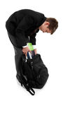 School boy packing school bag Royalty Free Stock Images