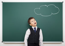 School boy and painted cloud having idea Stock Images