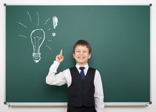School boy with painted lightbulb having idea Royalty Free Stock Photos