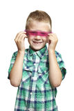 School boy with pink ruler Royalty Free Stock Image