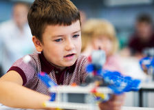 School Boy playing with construction set. Stock Photography