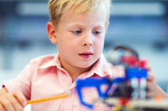 School Boy playing with construction set. Stock Photo