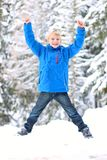 School boy playing in forest at winter Royalty Free Stock Image