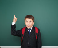 School boy portrait near board Royalty Free Stock Image