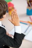 School boy with raised hand Royalty Free Stock Photography