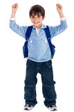School boy raising his hands up wearing school bag Stock Photos